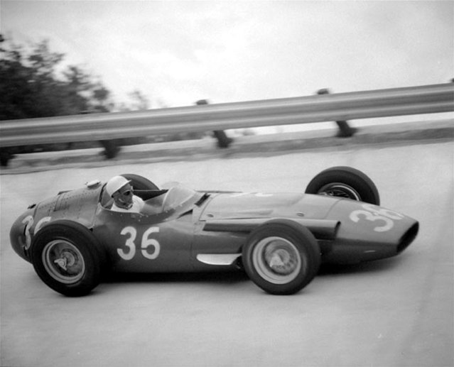 Stirling Moss of Great Britain drives his Maserati around a curve of the circuit at Monza, Italy, September 2, 1956 in the 300-mile Grand Prix of Europe. Moss won the race, beating world champion Juan Manuel Fangio. (Photo by AP Photo)