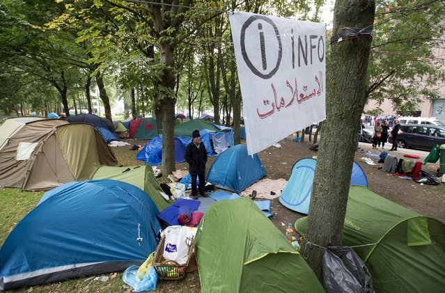 An asylum seeker waits in a makeshift camp outside the foreign office in Brussels, Belgium September 3, 2015. (Photo by Yves Herman/Reuters)