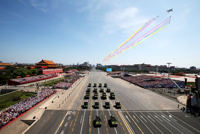 People's Liberation Army (PLA) aircraft and vehicles drive in formation past the Tiananmen Gate during a military parade marking the 70th anniversary of the end of World War Two, in Beijing, China, September 3, 2015. (Photo by Yao Dawei/Reuters/Xinhua)