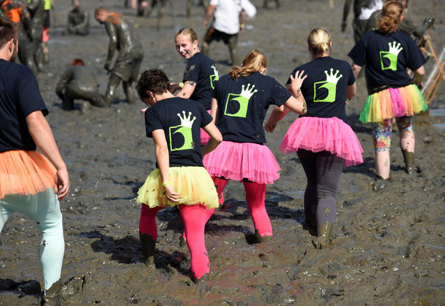 """Participants arrive at the pitch before their handball match at the so called """"Wattoluempiade"""" (Mud Olympics) in Brunsbuettel at the North Sea, Germany July 30, 2016. (Photo by Fabian Bimmer/Reuters)"""