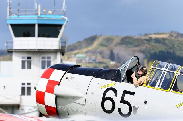 A pilot from the Roaring 40's Harvard display team prepares to take off during an airshow commemorating the rebuild of Havilland Mosquito KA 114, on September 29, 2012 in Ardmore, New Zealand. The plane was restored by Warbird Restorations at Ardmore Aerodrome and is the only flying Mosquito in the world.  (Photo by Simon Watts)