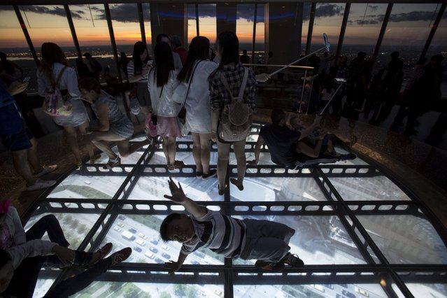 People gather at One World Observatory, the observation deck at One World Trade Center, in Lower Manhattan in New York September 11, 2015. (Photo by Andrew Kelly/Reuters)
