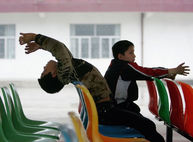 Chinese kids play at an assistance center February 24, 2005 in Shenzhen, Guangdong Province, China. (Photo by Cancan Chu/Getty Images)