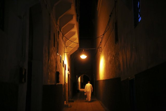 A man leaves a mosque after evening prayers in Medina, Rabat's old city September 23, 2014. (Photo by Damir Sagolj/Reuters)