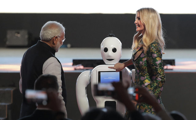 Indian Prime Minister Narendra Modi, left watches as U.S. presidential adviser and daughter Ivanka Trump presses the button on a robot during the opening of the Global Entrepreneurship Summit in Hyderabad, India, Tuesday, November 28, 2017. (Photo by Manish Swarup/AP Photo)