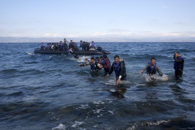Refugees and migrants arrive on an overcrowded dinghy on the Greek island of Lesbos, after crossing a part of the Aegean Sea from the Turkish coast, October 2, 2015. (Photo by Dimitris Michalakis/Reuters)