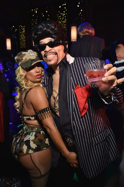 Coco Austin and Ice T attend Moto X presents Heidi Klum's 15th Annual Halloween Party sponsored by SVEDKA Vodka at TAO Downtown on October 31, 2014 in New York City. (Photo by Mike Coppola/Getty Images for Heidi Klum)