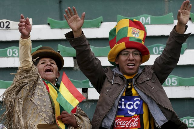 Fans of Bolivia cheer before the team's 2018 World Cup qualifying soccer match against Uruguay at the Hernando Siles Stadium in La Paz, Bolivia, October 8, 2015. (Photo by David Mercado/Reuters)