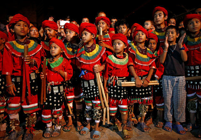 Boys dressed in traditional attire watch a performance as they wait for their turn during the Indra Jatra festival in Kathmandu, Nepal September 13, 2016. (Photo by Navesh Chitrakar/Reuters)