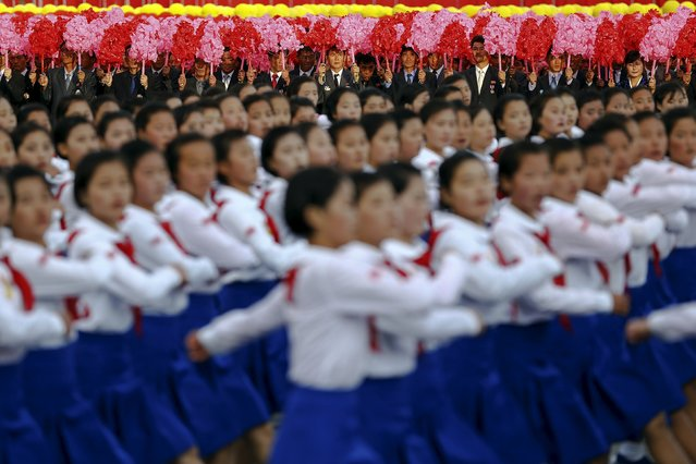 Schoolgirls march under the stands with North Korean leader Kim Jong Un and other officials during the parade celebrating the 70th anniversary of the founding of the ruling Workers' Party of Korea, in Pyongyang October 10, 2015. (Photo by Damir Sagolj/Reuters)