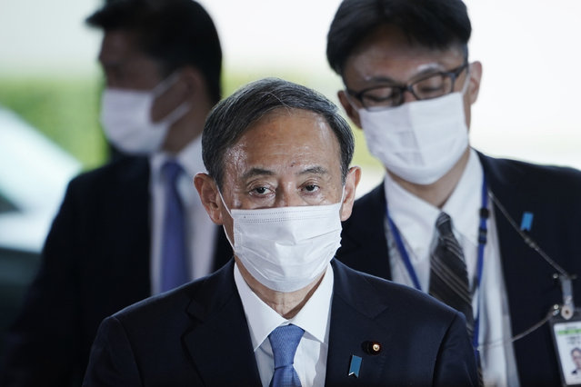 Japan's Prime Minister-elect Yoshihide Suga walks in the prime minister's office Wednesday, September 16, 2020, in Tokyo. Suga has been formally elected Japan's prime minister in a parliamentary vote, succeeding Shinzo Abe, (Photo by Eugene Hoshiko/AP Photo)