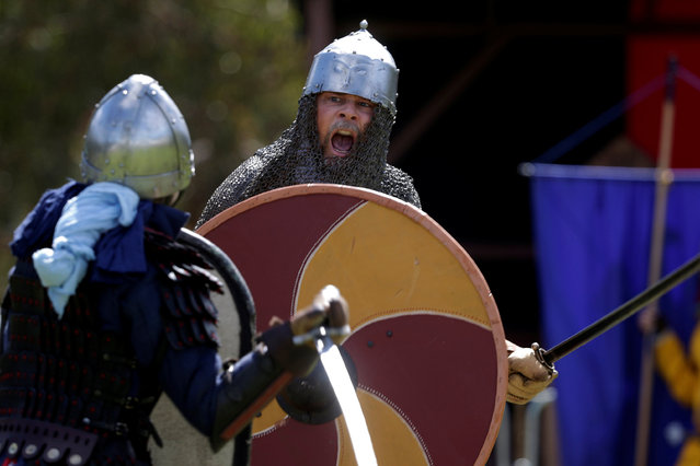 Participants in medieval garb participate in a battle scene at the St Ives Medieval Fair in Sydney, one of the largest of its kind in Australia, September 24, 2016. (Photo by Jason Reed/Reuters)