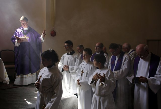 Catholic clergy take part in a morning prayer at the Al-Bishara Church in the West Bank town of Beit Jala, near Bethlehem March 10, 2013. Christian worshippers in the West Bank voiced hope on Sunday that the conclave of Roman Catholic cardinals will swiftly elect a successor to Pope Benedict XVI. (Photo by Ammar Awad/Reuters)