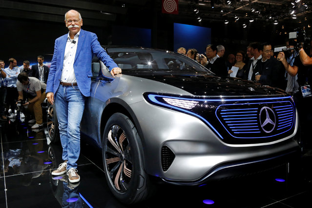 Dieter Zetsche, CEO of Daimler and Head of Mercedes-Benz, poses in front of a Mercedes EQ Electric car on media day at the Mondial de l'Automobile, the Paris auto show, in Paris, France, September 29, 2016. (Photo by Jacky Naegelen/Reuters)