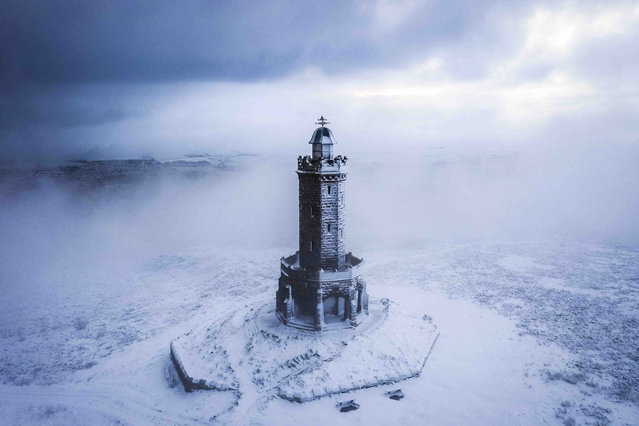 "Winter's Coming, Lancashire. Historic Britain runner-up. ""Shot with my drone on a cold February morning this year at Jubilee tower in Darwen. A favourite location of mine to fly my drone and particularly rewarding after some wintry weather. This wasn't an easy shot and on my walk to the tower visibility was less than 10 metres. Fortunately, the clouds cleared long enough to grab a few special pictures"". (Photo by Gregg Wolstenholme/UK Landscape Photographer of the Year 2020)"