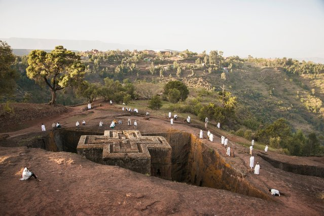 Pilgrims are seen nearing the cross shaped church of Bet Giyorgis in Ethiopia. (Photo by Philip Lee Harvey/Lonely Planet)