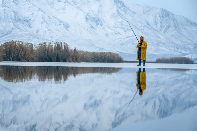 A man fishing on a part-frozen lake as it is zero celcius degree in Van, Turkey on November 30, 2017. (Photo by Ozkan Bilgin/Anadolu Agency/Getty Images)