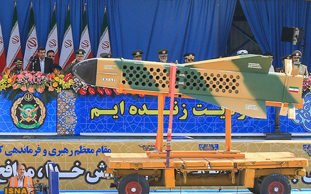 Iranian President Mahmoud Ahmadinejad (left) view the Iranian missile during military parade celebrating the country's Army Day in Tehran, on April 18, 2013. (Photo by Hamid Forootan/ISNA)