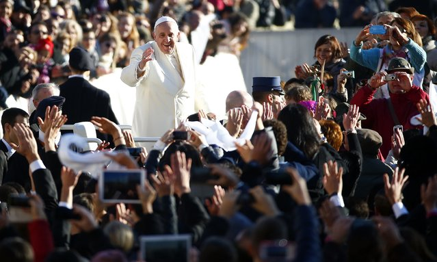 Pope Francis, who's 78th birthday is today, waves as he arrives to lead his general audience at the Vatican, December 17, 2014. (Photo by Tony Gentile/Reuters)