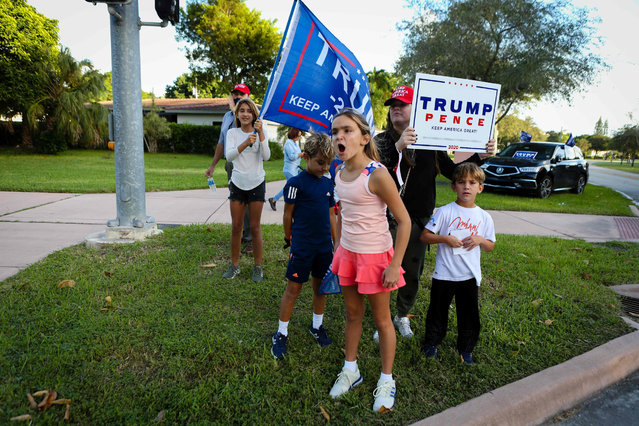 Supporters of US President Donald Trump rally in front of a poll station at Coral Gable Branch Public Library in Miami, Florida on November 3, 2020. (Photo by Eva Marie Uzcategui/AFP Photo)