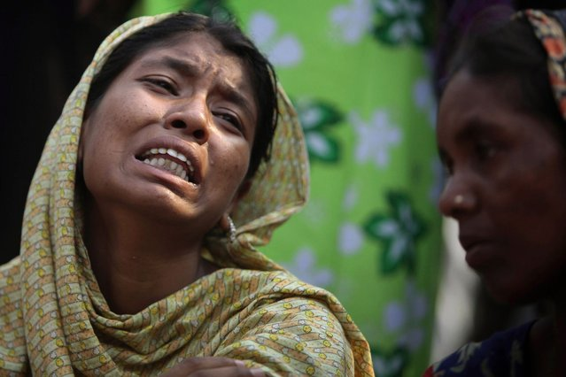 A Bangladeshi relative of a victim cries at the site of a building that collapsed Wednesday in Savar, near Dhaka, Bangladesh,Thursday, April 25, 2013. By Thursday, the death toll reached at least 194 people as rescuers continued to search for injured and missing, after a huge section of an eight-story building that housed several garment factories splintered into a pile of concrete. (Photo by A. M. Ahad/AP Photo)