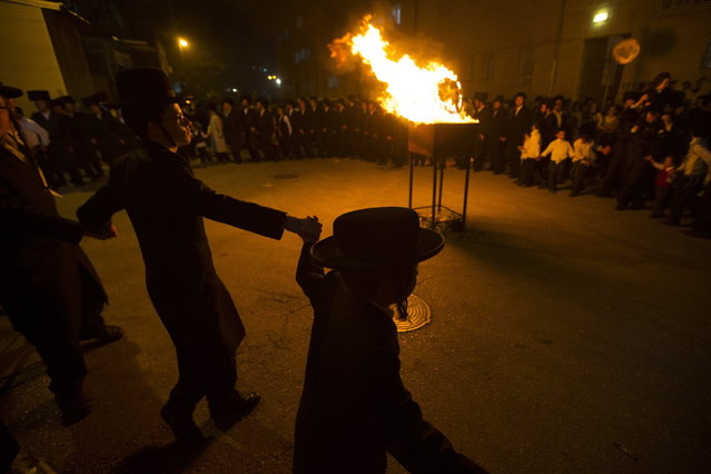 Ultra Orthodox Jews celebrate the Jewish holiday of Lag Ba-Omer in Jerusalem's Mea Shearim neighbourhood April 27, 2013. Israelis celebrate the Jewish holiday of Lag Ba-Omer, which marks the end of a plague in the Middle Ages that killed thousands of disciples of a revered rabbi in the holy land, by lighting bonfires across the country. (Photo by Ronen Zvulun/Reuters)