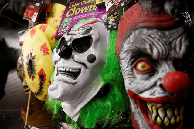 Creepy clown masks are displayed at a Halloween store in the Brooklyn borough of New York City, U.S. October 20, 2016. (Photo by Brendan McDermid/Reuters)
