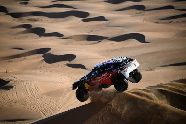 Peugeot's driver Khalid Sheikh al-Qassimi of Saudi Arabia and co-driver French Xavier Panseri compete during Stage 2 of the Dakar Rally 2021 between Bisha and Wadi Ad-Dawasir in Saudi Arabia, on January 4, 2021. (Photo by Franck Fife/AFP Photo)