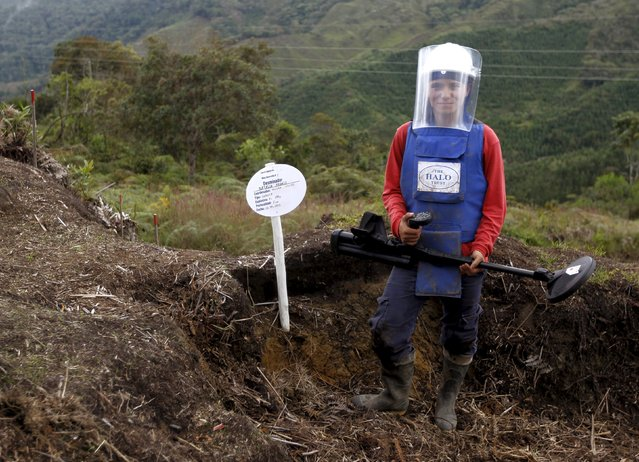Natalia Arango poses with her mine detector in a zone of landmines planted by rebel groups near Sonson in Antioquia province, November 19, 2015. (Photo by Fredy Builes/Reuters)