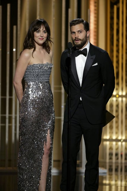 Actors Dakota Johnson (L) and Jamie Dornan present at the 72nd Golden Globe Awards in Beverly Hills, California January 11, 2015. (Photo by Paul Drinkwater/Reuters/NBC)