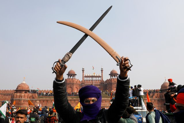 A farmer holds a sword during a protest against farm laws introduced by the government, at the historic Red Fort in Delhi, India, January 26, 2021. (Photo by Adnan Abidi/Reuters)