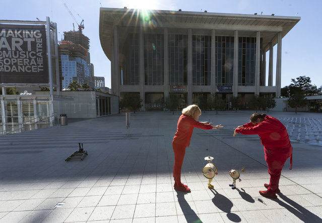 Members of the Bob Baker Marionette Theater keep their social distance as they practice on the Dorothy Chandler Pavilion's courtyard in Los Angeles Friday, February 5, 2021. Due to the coronavirus pandemic, the Bob Baker Marionettes have gone digital worldwide, as the public can now tune in for a personalized Zoom puppet experience. (Photo by Damian Dovarganes/AP Photo)