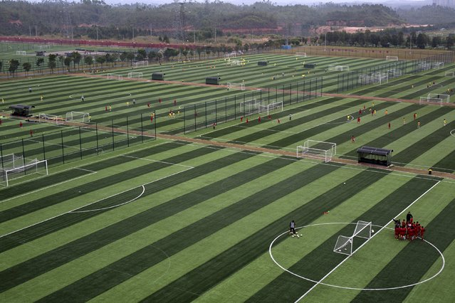 A view shows some of the 50 pitches at Evergrande soccer academy in Qingyuan, southern China December 3, 2015. (Photo by Tyrone Siu/Reuters)