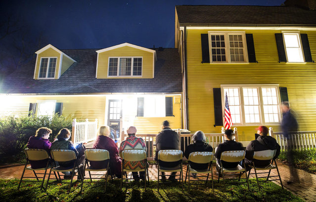 "Virginia residents wait in line in the pre-dawn hours to vote in the the 2016 US presidential election before the polls open at an historic property called the ""Hunter House"" at Nottoway Park in Vienna, Virginia, USA, 08 November 2016. US Americans are called to the polls in the election to chose the 45th President of the United States of America to serve from 2017 through 2020. (Photo by Jim Lo Scalzo/EPA)"