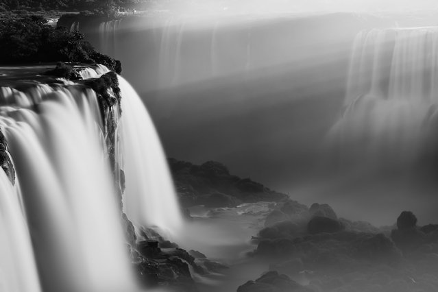 """""""Iguazy sun rays"""". Spectacular sunset at Iguazu Falls, Brazil, following a stormy day. (Photo and caption by Timo Lieber/National Geographic Traveler Photo Contest)"""