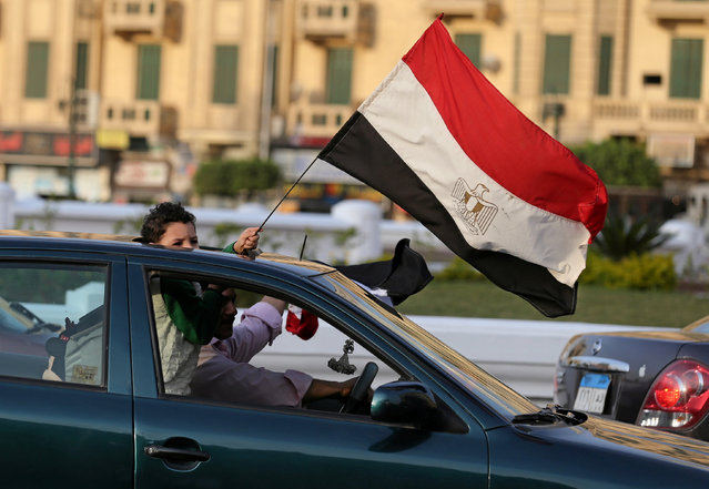 A boy and his father carry Egyptian flags as they support Egyptian President Abdel Fattah al-Sisi at Tahrir square in Cairo, Egypt, November 11, 2016. (Photo by Mohamed Abd El Ghany/Reuters)