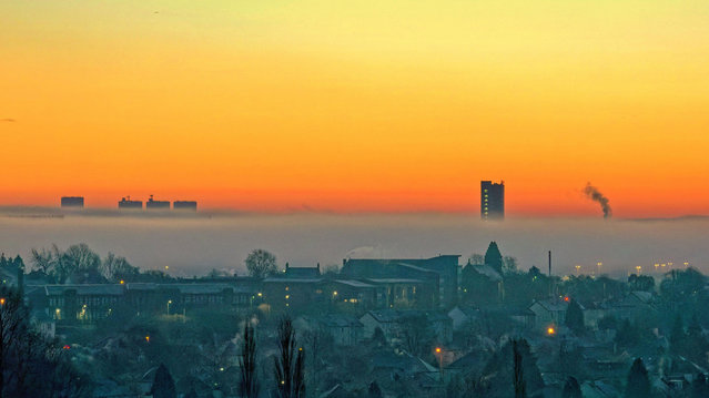 Glasgow, Scotland on January 24, 2021. Dawn saw the city wake to an iced landscape as overnight temperatures plummeted in the north as dawn revealed an air fog that enchanted the scenery making fantasy pictures of the buildings and parks. (Photo by Gerard Ferry/Alamy Live News)