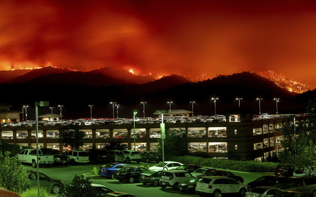 Flames from the County fire burn above Cache Creek Casino Resort on Saturday, June 30, 2018, in Capay, Calif. (Photo by Noah Berger/AP Photo)