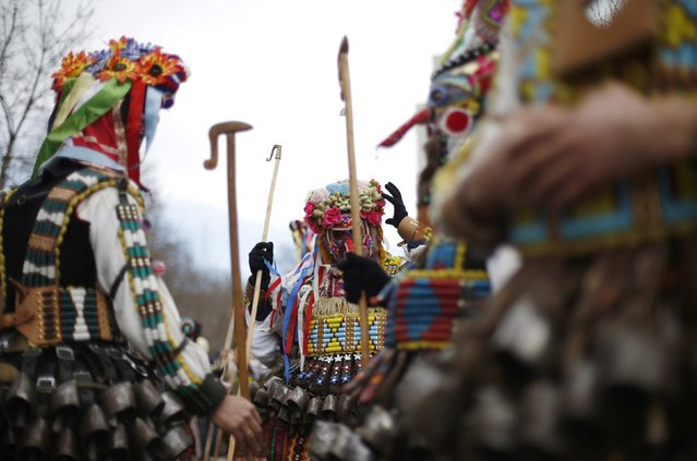 "Men dressed in costumes, known as ""kukeri"", participate in the International Festival of the Masquerade Games in the town of Pernik January 31, 2015. (Photo by Stoyan Nenov/Reuters)"