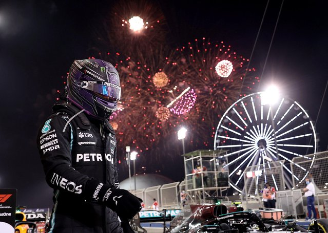 Race winner Lewis Hamilton of Great Britain and Mercedes GP celebrates in parc ferme during the F1 Grand Prix of Bahrain at Bahrain International Circuit on March 28, 2021 in Bahrain, Bahrain. (Photo by /Lars Baron/Reuters)