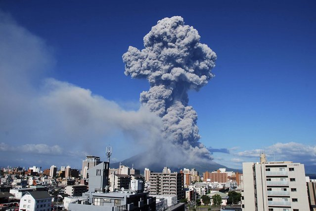 Smoke rises after an eruption of Mount Sakurajima in Kagoshima, Japan, on August 18, 2013. The eruption on Sunday of the 3665 ft. high volcano, one of Japan's most active volcanoes, sent up a 16,404 ft.plume, the highest in recorded history. It is also the volcano's 500th eruption this year, according to media reports citing the local meteorological observatory. (Photo by Kagoshima Local Meteorological Observatory)