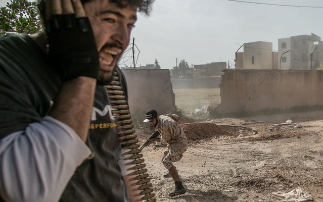 Fighters of the UN-backed Government of National Accord (GNA) take cover during clashes with Libyan National Army (LNA) at Salah Al-Din frontline in Tripoli, Libya, April 18, 2020. Libya's UN-backed government's forces said they launched 17 airstrikes on the east-based army positions in Tarhuna, some 90 kilometers south of the capital Tripoli, seizing a number of military vehicles. Despite international call for cease-fire in Libya, the deadly armed conflict has continued with collateral civilian casualties. (Photo by Xinhua News Agency/Rex Features/Shutterstock)