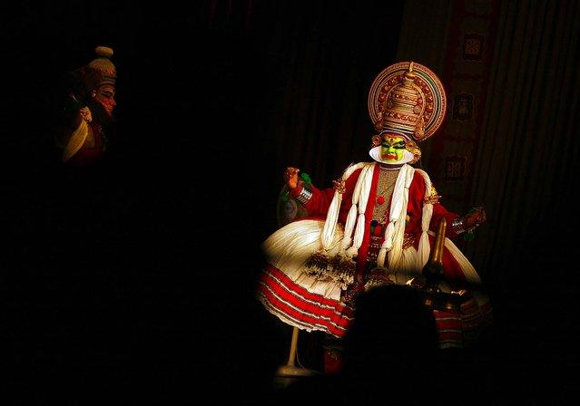 Indian Kathakali artists perform in Chennai, India, on September 4, 2013. Kathakali is a classical dance that was created in the ancient kingdoms that now make up Kerala, a state on India's southwestern coast some 400 years ago. (Photo by Arun Sankar K/Associated Press)