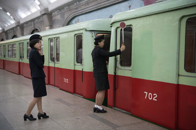 A conductor indicates  to a driver on the Pyongyang metro on August 21, 2018 in Pyongyang, North Korea. (Photo by Carl Court/Getty Images)
