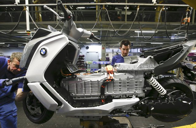 A mechanic assembles a BMW C evolution electric maxi-scooter at the BMW Berlin motorcycle plant February 23, 2015. (Photo by Fabrizio Bensch/Reuters)