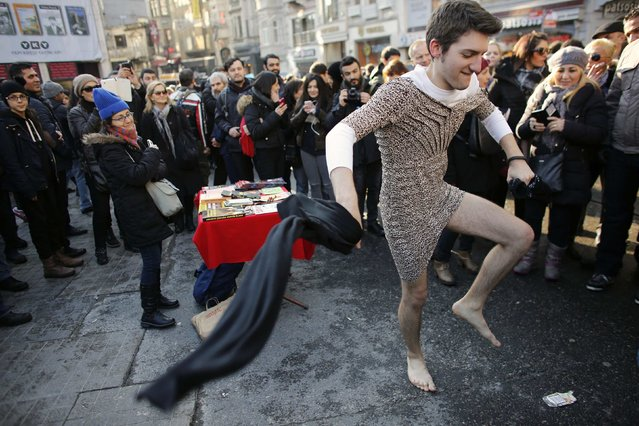 "Kaan Vural, a Turkish-South African man, wears a woman's dress to take part in a protest against domestic violence, in central Istanbul February 21, 2015. Turkey's president on February 16, 2015, described violence against women as the ""bleeding wound"" of the country after a woman was stabbed and beaten to death after trying to fight off a man trying to rape her. Despite a surge in violence against women in Turkey last year, the particularly brutal, and public, attack on Ozgecan Aslan, 20, has become a rallying point, prompting protests and condemnation by politicians. (Photo by Murad Sezer/Reuters)"
