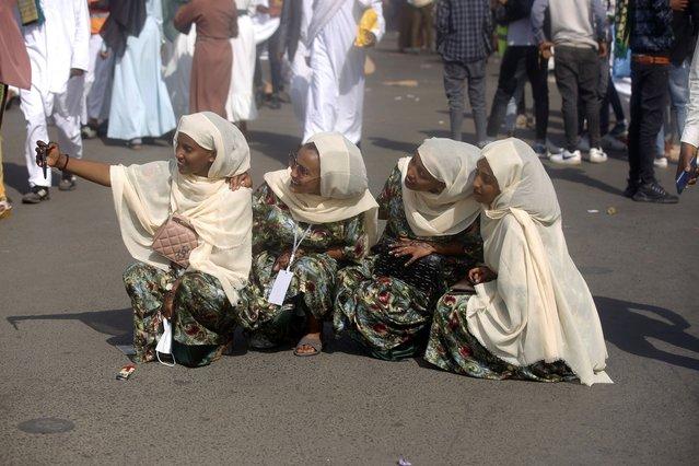 Muslims arrive to perform Eid al-Fitr prayer within precautions against the novel coronavirus (COVID-19) pandemic, in Ethiopia, Addis Ababa on May 13, 2021. (Photo by Minasse Wondimu Hailu/Anadolu Agency via Getty Images)