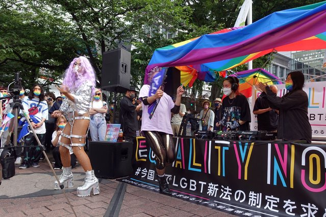 Dozens of LGBTQ activists and supporters of equal rights laws gather at the Shibuya district Sunday June 6, 2021, in Tokyo. Dozens of sexual minority activists and supporters rallied for equal rights outside a main Tokyo station Sunday in an effort to gain public support to get their long-sought equality law enacted before the Olympics amid thinning hope because of the conservative governing party's resistance. (Photo by Mari Yamaguchi/AP Photo)