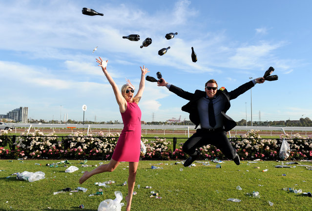 Race goers enjoy the atmosphere at the end of the day at the Melbourne Cup at Flemington Racecourse in Melbourne, Tuesday, November 5, 2013. (Photo by Dan Himbrechts/AAP/Press Association Images)