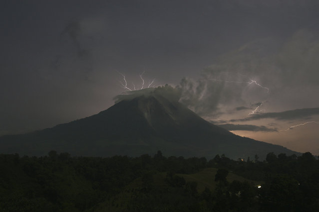 Lightning strikes as Mount Sinabung volcano spews ash and hot lava, at Simpang Empat village in Karo district, September 18, 2013. (Photo by Y. T. Haryono/Reuters)